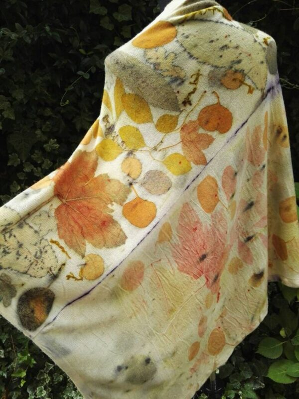 Hand dyed cashmere poncho with imprinted leaves and plants.