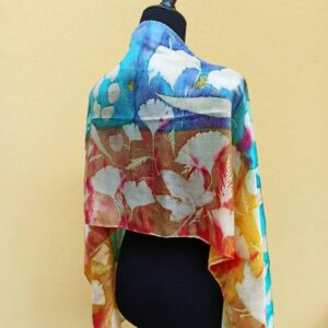 Blue and yellow hand dyed 100% silk scarf with imprinted leaves and flowers. Original colorful accessory to complete any outfit.